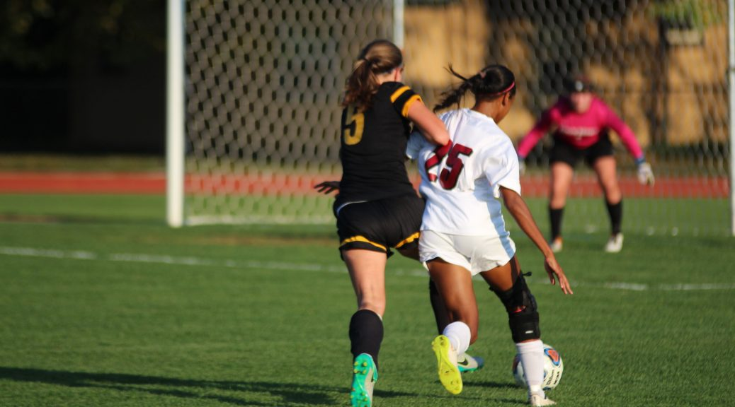 Kendall Logan '18 slides past a defender on her way to goal